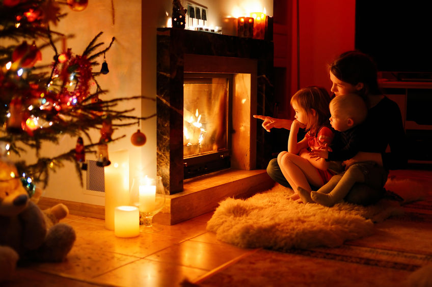 mother and her daughters by a fireplace